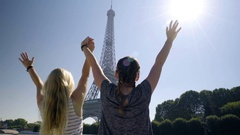 Young Women Ride Boat, Hold Hands/Raise Arms In Air, Excited To See Eiffel Tower Stock Footage