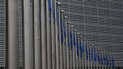 European flags waving in the wind, outside the European Council in Brussels Stock Footage