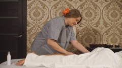 A woman doing therapeutic massage calf Stock Footage