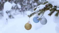 Snowy Spruce Branch and Three Christmas Balls Stock Footage