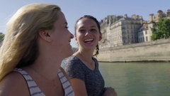 Adventurous Young Women Explore Paris Together By Tour Boat, They Chat And Laugh Stock Footage
