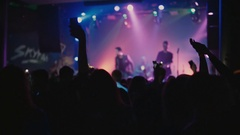 Crowd waving hands in the night club party Stock Footage