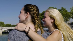 Young Women Sightseeing In Paris From Tour Boat, Point And Talk About Landmarks Stock Footage