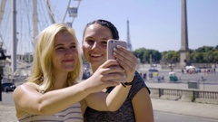 Happy Tourists Take Selfies In Front Of Ferris Wheel, Eiffel Tower In Distance Stock Footage