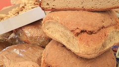 Heap of freshly baked traditional bread on stall at the bazaar Stock Footage