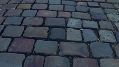 Ancient urban pavement close-up 4K steadicam video Stock Footage
