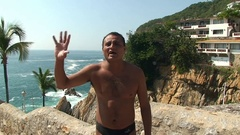 Quebrada cliff diver welcomes spectators. Mexico, Acapulco. Stock Footage