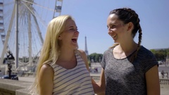 Young Women Laughing On Vacation In Paris, Ferris Wheel/Eiffel Tower Behind Them Stock Footage