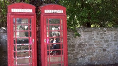Scotland Highlands county of Sutherland old town of Dornoch two telephone boxes Stock Footage