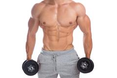 Bodybuilder bodybuilding muscles upper body strong muscular man dumbbells a.. Stock Photos