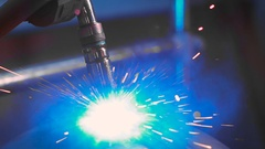 Bright sparks fly during the work of welding machine on production. Automated Stock Footage