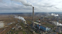 Aerial - Pollution industry. Smoking power plant in a huge industrial area Stock Footage