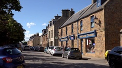 Scotland Highlands county of Sutherland typical British street in Dornoch Stock Footage