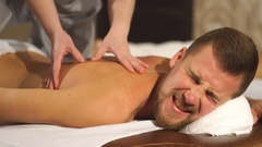 Young man relaxing back massage Stock Footage
