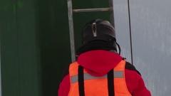 Mountain Rescuer goes on ski lift Stock Footage