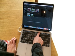 Woman testing laptop with Touch Bar movie iMovie making app Stock Footage