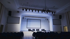 Modern concert hall. Scene is brightly lit professional lighting equipment Stock Footage