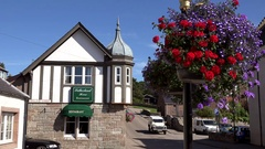 Scotland Highlands Sutherland Dornoch colorful flowers on town square Stock Footage