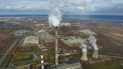 Aerial flying over dirty exhaust area. Heavy industry factories area, smoke from Stock Footage