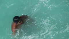 Quebrada cliff diver look around after jump. Mexico, Acapulco. Stock Footage