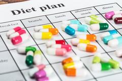 Pills on a plan of reception during the day Stock Photos