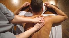 Shooting from above. man doing a shoulder and back massage,relaxing,relaxation Stock Footage