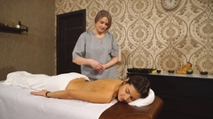 Girl on a stone therapy, hot stone massage Stock Footage