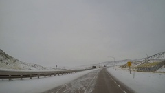 POV Driving Shot - Snow/Ice Covered Interstate 80 near Evanston, Wyoming Stock Footage