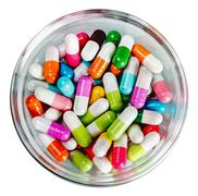 Many different colored pills Stock Photos