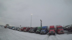 POV Driving Shot - Rows of Parked Semi-Trucks at a Truck Stop in Altoona, Iowa Stock Footage