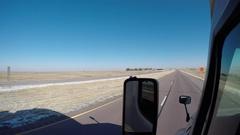 Semi-Truck Exterior Nebraska Interstate 80 - Another Semi Passes on the Left Stock Footage