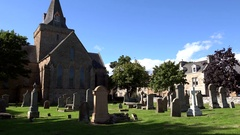 Scotland Highlands county of Sutherland church and graveyard of Dornoch Stock Footage