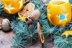 Oranges pierced with cloves, Christmas spices and nuts Stock Photos