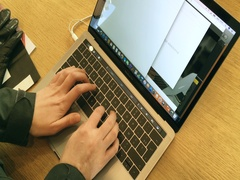Woman testing laptop with Touch Bar writing email send email Stock Footage