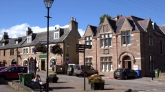Scotland Highlands county of Sutherland Dornoch town square with benches & homes Stock Footage