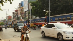 City street with car traffic and passing Stock Footage