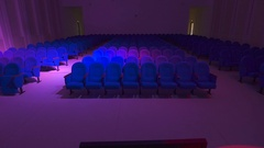Modern concert hall with a lot of seats. Room off the main light and only Stock Footage