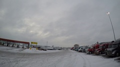 Driving POV - Rows of Parked Semi-Trucks at a Truck Stop in Altoona, Iowa, USA Stock Footage