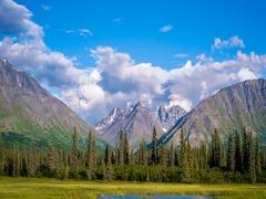 Clouds rolling across mountain peaks in Alaska Stock Footage