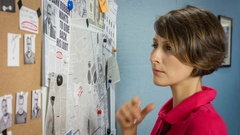 Woman detective closely examining the crime scene and a gang of criminals Stock Footage