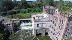 Aerial. Ruins of  old mill or small hydroelectric power stations.  Stock Footage