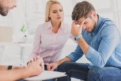 Anxious woman with man in desperation Stock Photos