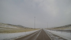 Driving POV - Snow/Ice Covered Highway in Rural Ft. Bridger, Wyoming, USA Stock Footage