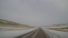 Driving POV - Snow/Ice Covered Highway in Rural Rock Springs, Wyoming, USA Stock Footage