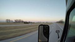 Exterior Shot - A Semi Passes in the Left Lane in Rural Nebraska Stock Footage