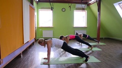 Young people do yoga indoors Stock Footage