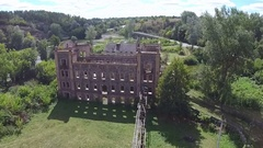 Aerial. Ruins of  old mill or hydroelectric power stations. Camera inclination Stock Footage
