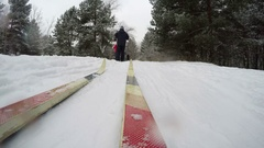 Concept Winter Healthy Lifstyle. Cross Country Skiing on Snowy Winter Day. POV Stock Footage