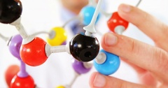 Close-up of scientist holding molecule model Stock Footage