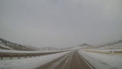Semi-Truck Exterior - Snow/Ice Covered Highway in Rural Wyoming, USA Stock Footage